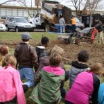 Fifth graders look on with curiosity as Daniel's Garden Center tills our ground for a huge expansion of the Salford Hills fruit & vegetable garden.