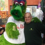 Daniel's Lawn and Garden Owner Stu Strauss with the Phillie Phanatic at the Warm Hugs for for Vets event.