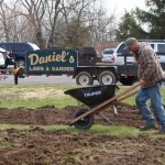 Workers mixed in topsoil and mulch after tilling a 20x20ft. pumpkin patch and a 50x50ft. area for vegetables for the Salford Hills Elementary School Garden